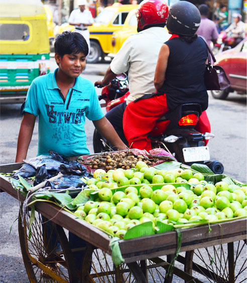 A young fruit seller in the streets of Kolkata. Photo: Sayamindu Dasgupta