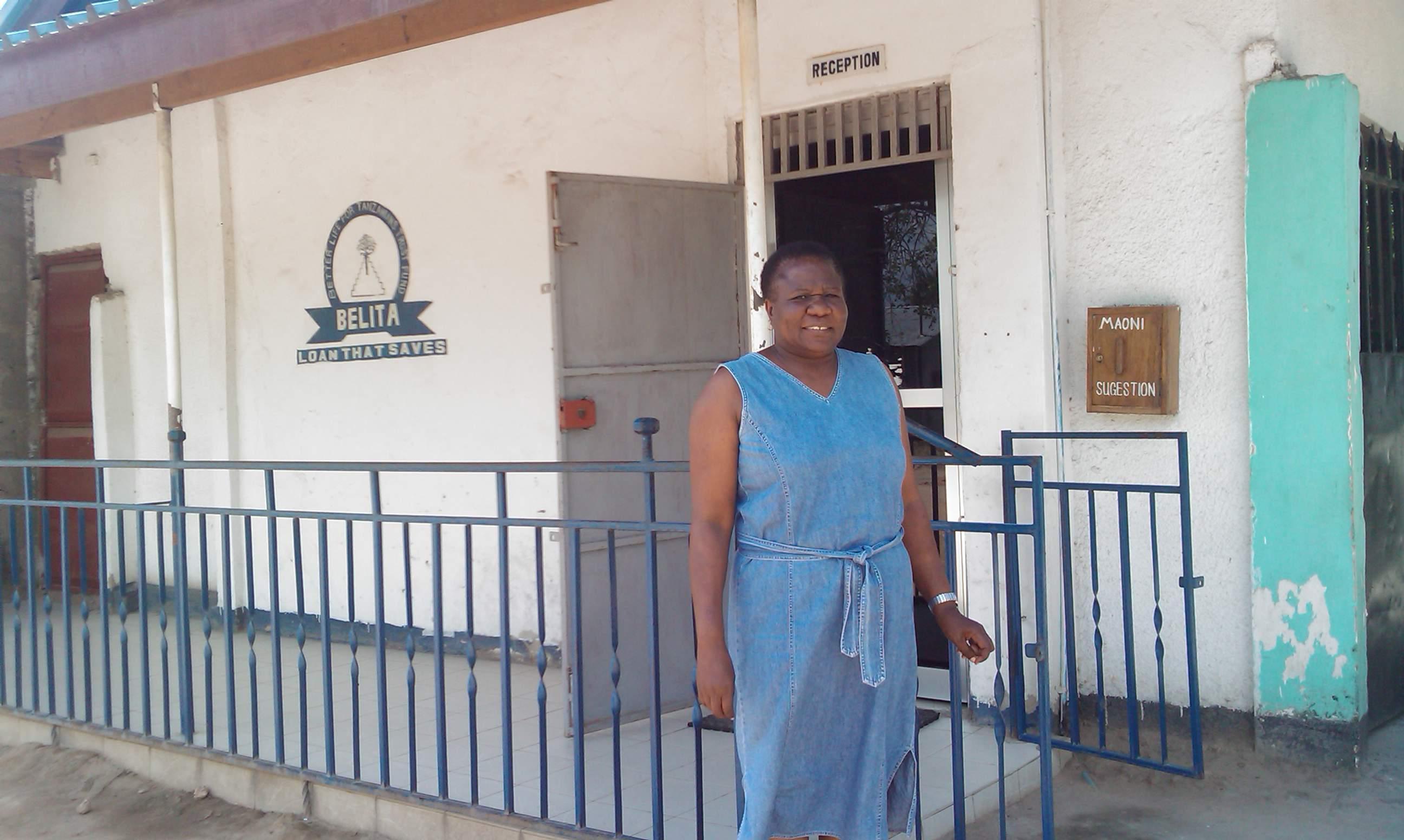Helena, the BELITA founder, standing in front of the servant's quarter's old BELITA office.